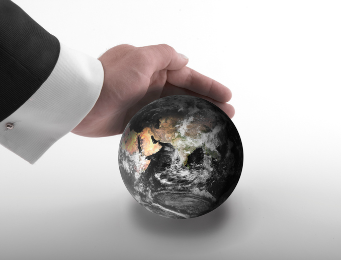 Man reaching out the globe with tender and care as if to protect. A CSR concept