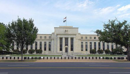 Fed Keeps Rates Flat, Upgrades Economy to 'Strong'